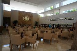 Bar area with plenty of chairs and tables at Bahia Principe Sian Kaan lobby.jpg