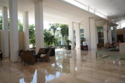 Shiny marble floors and chairs with tall white ceiling at Bahia Principe Sian Kaan lobby.jpg