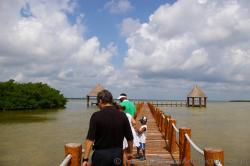 Bridge to two pavilions at the Playa Mujeres lagoon area.jpg
