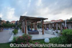 Outdoor Canopies with beds and seats with white drapes at Ocean Coral & Turquesa.jpg